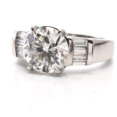 like the shank and setting, but with 2 round diamonds on each side instead of baguettes