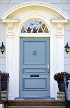 sky blue front door, ornamental lighting add curb appeal