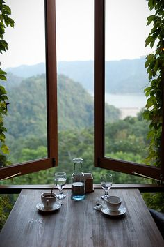 Table against open window looking out on mountains and water