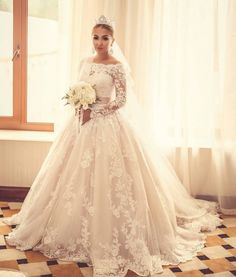 Long sleeve wedding dresses tend to have a very traditional appearance. This elegant lace ball gown is timeless.  We are in the USA and can create custom wedding dresses like this for you at a great cost. Inexpensive #replicas of high end couture bridal gowns are also an option with our firm.  Contact us for pricing at