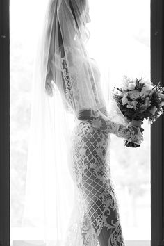 Lost In Love Photography / Destination Photographer / Black and White / Beaded Fitted Bridal Gown / Veil / Wedding Style Inspiration / The LANE