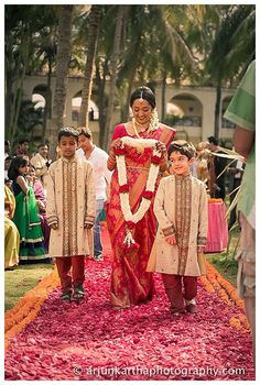 The pretty bride walking down the aisle with the adorable kids. Love Love!