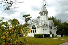 Beautiful white wooden country church in a picturesque setting. Stock Photo - 2330628