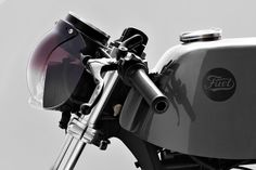 Brilliant idea: that is a Biltwell bubble shield as headlight cover on this Fuel Motorcycles R65