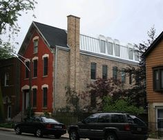 Keeping the masonry shell of this classic Old Town flat, the design team removed the entire interior and created a modern open plan defined by a three-story atrium under curved metal dormers.