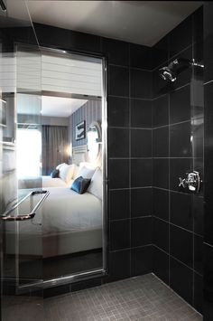 that wall between the shower and the bedroom was always cosmopolitan