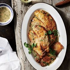 Tilapia with Lemon-Garlic Sauce Recipe - We all liked this. I used some flour and cornstarch to dredge and it gave a nice crispiness to the tilapia - Cassie Healthy Menu, Healthy Cooking, Healthy Eating, Healthy Recipes, Easy Cooking, Delicious Recipes, Healthy Foods, Clean Eating, Tilapia Recipes