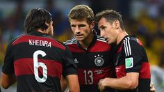 Miroslav Klose of Germany celebrates scoring his team's second goal with teammates Sami Khedira and Thomas Mueller
