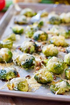 SMASHED Brussels Sprouts - crispy on the outside, creamy in the middle with a pinch of asiago! #veggies #sheetpan veggies #brusselssprouts