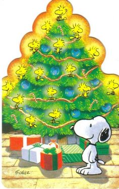 Snoopy Standing in Front of a Christmas Tree With Woodstock and Friends as Tree Decorations and Lights