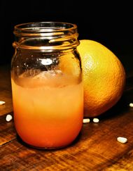 Fuzzy Moon  2 oz. Palmetto Moonshine 1 oz. peach schnapps 3 oz. orange juice splash of grenadine