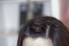 A pin curl at the center front helps keep a wig in place.