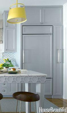 Ann Sacks's Beau Monde Mosaics backsplash harmonizes with kitchen cabinets painted in Benjamin Moore's Blue Springs.