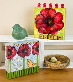 Create this project with Americana® Acrylics — These two canvases are highlighted by the showy poppy flower and Americana® Acrylics.