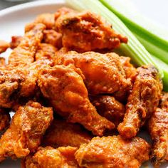 Crispy Buffalo Chicken Wings with Chicken Wings, Baking Powder, Salt, Garlic Powder, Cracked Pepper, Butter, Hot Sauce, Granulated White Sugar, Crumbled Blue Cheese, Sour Cream, Mayonnaise, Garlic, Lemon Juice, Salt, Cracked Black Pepper, Ranch Dressing, Blue Cheese Dressing, Celery Sticks.