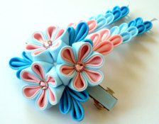 A flower is made in the technique of tsumami kanzashi. Flower is made from grosgrain ribbons. Swarovski crystal. Mounted on a large 3 1/2 inch ( 95 mm) barrette hair clip.      At your request can be made a flower of a different color combinations.    My handworks can be a unique gift for you, your family and friends