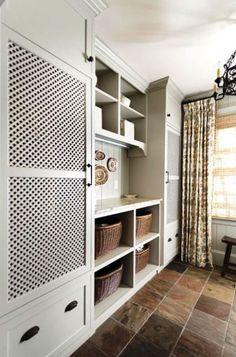 hidden laundry appliances - custom cabinets conceal laundry appliances - Revival Construction via Atticmag Laundry Doors, Mudroom Laundry Room, Laundry Room Design, Hidden Laundry Rooms, Laundry Chute, Hidden Kitchen, Laundry Area, Laundry Storage, Garage Storage