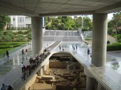 Top 20 things to do in Athens: The entrance of the Acropolis Museum, with visible ruins at the bottom