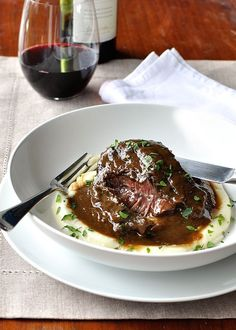 Unbelievably tender with a thick sauce made from the braising liquid. SO EASY and so cost effective. Directions for slow cooker, oven and stovetop. #crockpot #braised #red_wine