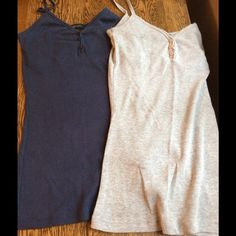 2 Tank Bundle 2 tanks!! A blue & a gray ribbed tank with a small ruffle across the neckline, they also have a built in bra shelf. Both are in good condition but the gray top's seam of the bra shelf has come apart. It isn't ripped just needs sewn back together. Tops Tank Tops
