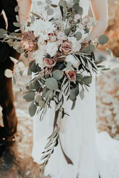 Blush, ivory, and sage green cascading bridal bouquet | Image by Andy Roberts Photography