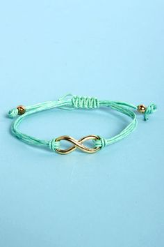 Check it out from Lulus.com! You can count on the Forever Charming Mint Green Friendship Bracelet to always take your outfit to new levels of cute! Mint green cords hold a shiny gold infinity charm, while a simple tug to two gold beads will help you adjust to the perfect fit. Bracelet measures 3