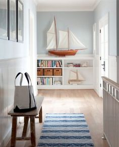 Light and airy beach cottage entry foyer landing.  Nautical blue and white.