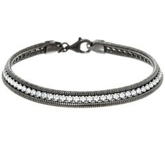 A captivating classic. This tennis bracelet shines with round Diamonique(R) simulated diamonds prong set between two rows of polished snake chain. QVC.com