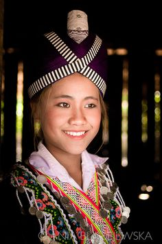 Laos, Muang Sing. Hmong girl wearing beautiful dress because of the Hmong New Years festival.