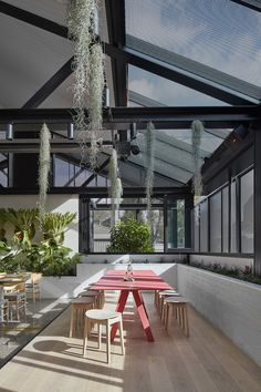 A former auto repair garage has been transformed by Mim Design into a contemporary hospitality space in the guise of a sprawling indoor botanical garden. Commercial Interior Design, Best Interior Design, Commercial Interiors, Mim Design, Cafe Design, Store Design, Design Art, Botanical Interior, Cafe Pictures