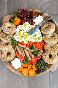For entertaining how to create a DIY Lox and Bagels Board with fresh ingredients! Add lox bagels cream cheese tomatoes capers and more! Charcuterie Recipes, Charcuterie And Cheese Board, Meat Cheese Platters, Cheese Boards, Brunch Recipes, Breakfast Recipes, Breakfast Ideas, Lox And Bagels, Breakfast Platter