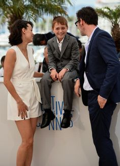 (L-R) Actors Berenice Bejo, Abdul Khalim Mamutsiev and director Michel Hazanavicius attend 'The Search' photocall at the 67th Annual Cannes Film Festival on May 21, 2014 in Cannes, France.