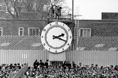 The famous clock at Highbury's Clock End. The fence seen at the bottom left-hand side is likely to be there to separate the rival supporters. Aubameyang Arsenal, Arsenal Football, Football Stadiums, Football Fans, Football Stuff, British Football, Retro Football, Vintage Football, Soccer Pictures