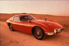 The Toyota is a hardtop coupe grand tourer that Toyota and Yamaha designed together with a limited run, only 351 models were made Toyota 2000gt, Jaguar, Fuel Cell Cars, Type E, Toyota Cars, Japanese Cars, My Ride, Old Cars, Classic Cars