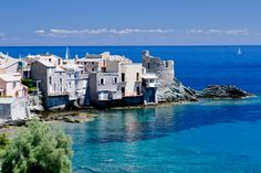 On the east coast of Cap Corse, a few kilometers from Bastia, Corsica, Erbalunga is a peaceful town remarkable for its Genoese tower of the sixteenth century bathed in clear waters inviting you to plunge in. © Blende-8 - Fotolia.com