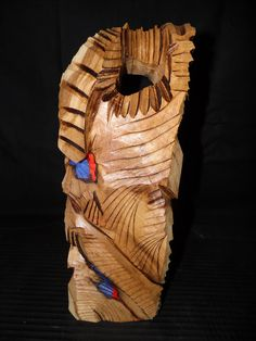 An abstract Totem sculpture made from Oak.