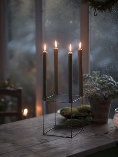 The 'Ståtlig' candle holder from Swedish company Zetas. This is such an evocative image. Christmas Trends, Scandinavian Christmas, Rustic Christmas, Christmas Inspiration, Winter Christmas, Christmas Wreaths, Christmas Decorations, Holiday, Advent Candles