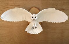 Hand made paper and wood wall mounted owl by ZackMclaughlin
