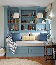 The owners of this Massachusetts house outfitted their son's room with a built-in daybed and bookshelves. The trim is painted Van Courtland Blue by Benjamin Moore. - HouseBeautiful.com