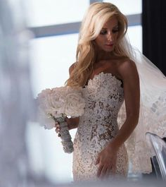 I don't know -- what do you think? I don't like to think I'm a fuddy duddy but I don't like wedding gowns that look like lingerie. Sexy doesn't have to be so obvious. But really, what do you think?