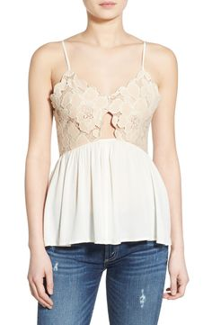 Sweet and feminine, this lace peplum top adds a flirty vibe to any spring ensemble.