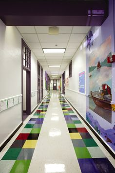 Fair Park Elementary by Herron Horton. I really like to Purple trim and doors and then color blocking in the floor pattern.