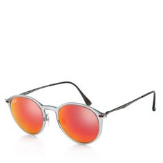 Simple casual cool: Ray-Ban sunglasses in pink and orange. Fashionette.de