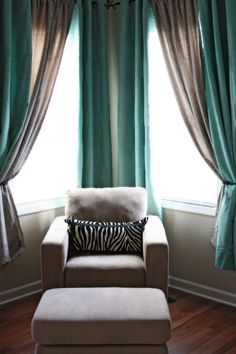I love the curtains & colors: grey & blue-I would have to add a great lamp, but great cozy reading corner