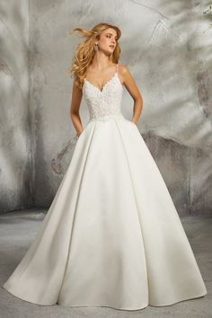 Mori Lee Bridal 8272 wedding dress available at The Castle. We are an authorized… Mori Lee Bridal 8272 wedding dress available at The Castle. We are an authorized retailer for all Mori Lee Bridal dresses and every 8272 is brand new with all original tags! Boho Wedding Dress With Sleeves, Classic Wedding Dress, Perfect Wedding Dress, Bridal Wedding Dresses, Wedding Dress Styles, Dream Wedding Dresses, Princess Wedding Dresses, Mori Lee Wedding Dress, Satin Wedding Dresses