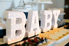 Decorated letters at a navy and gold baby shower! See more party planning ideas at CatchMyParty.com!