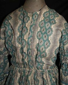 """1850s teal stripe challis [wool?], roller printed... Mostly hand sewn. Pagoda sleeves trimmed in matching green ribbon and double ruching around armsycyes. Piped at neck, waist & armcyes, bodice has original concealed hooks & eyes and is fully lined with cream linen & window pane linen, cartridge pleating on skirt, hem edged with green hem protector, right side pocket on skirt, skirt lined with floral calico. Bust: 32""""; Waist: 28""""; shoulders across: 17""""; total length: 57"""" in back."""