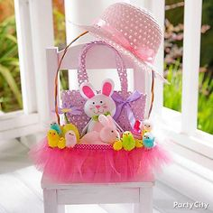 Here's a tutu-cute basket for little girls! Make a mini tutu from tulle and hot-glue it around the bottom of a pink Easter basket. Put the final touches by accenting it with a strip of polka-dot ribbon!