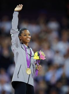 Gabby Douglas of the U.S. waves on the podium after receiving her gold medal during the women's individual all-around gymnastics final in the North Greenwich Arena during the London 2012 Olympic Games August 2, 2012.