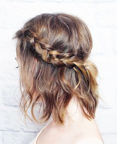 We have a feeling this cute, tousled style will be your new go-to look for keeping bangs or short layers out of your face this summer. Create a classic three-strand braid on each side of your head and secure in the back with a thin elastic. Keep the braids in place with a few strategic bobby pins so they don't move around as you're getting #UpNOut throughout the day. Add a small amount of texturizing pomade—we love Aveda Light Elements Texturizing Creme ($24) to the ends to create cool-girl…